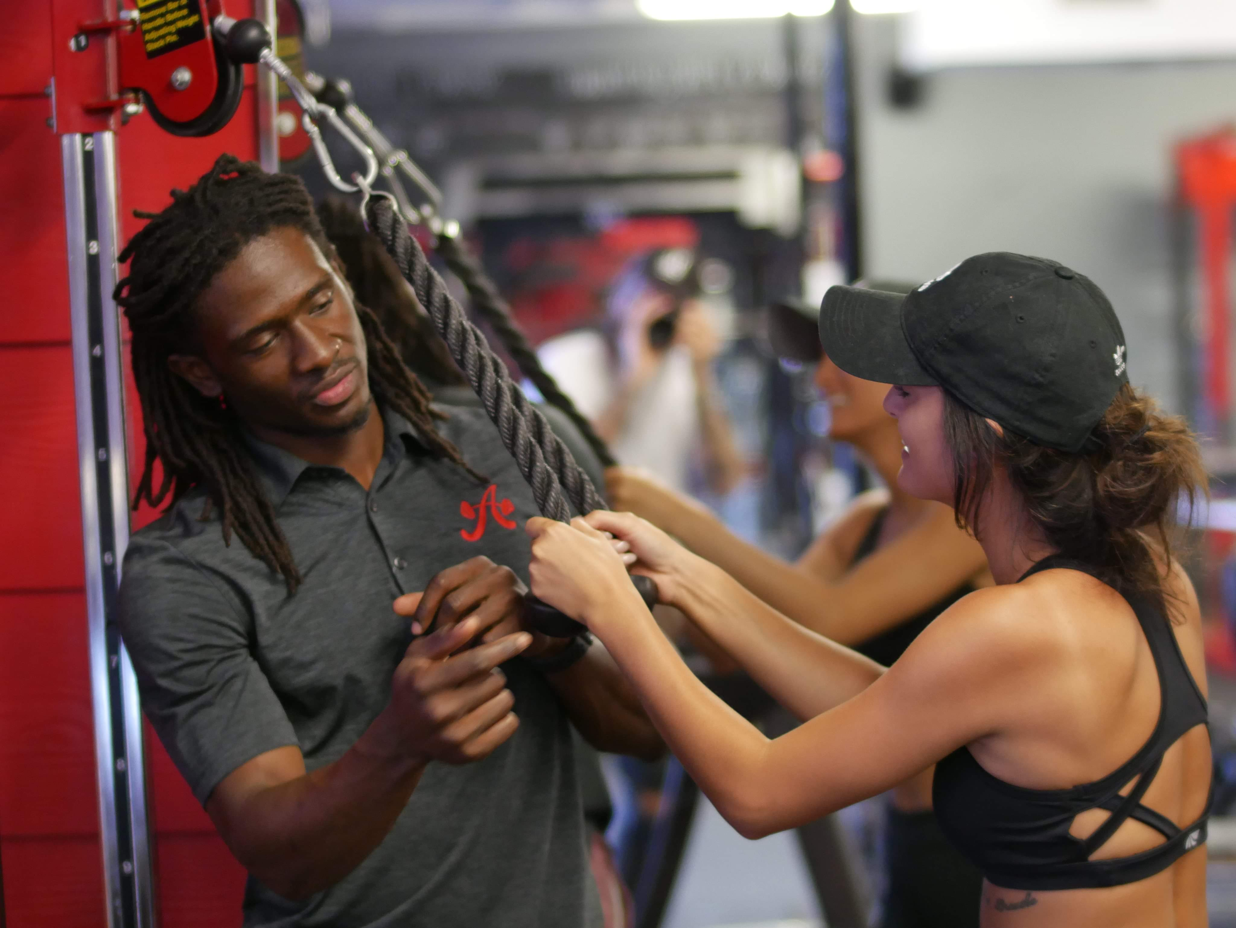 Certified personal trainer, Darryl Payne, with an Austin Simply Fit client